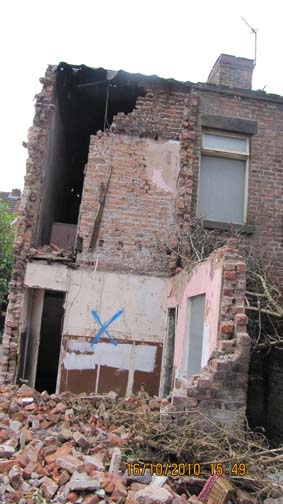 The rear of No.65 Cairns Street, smashed by contractors