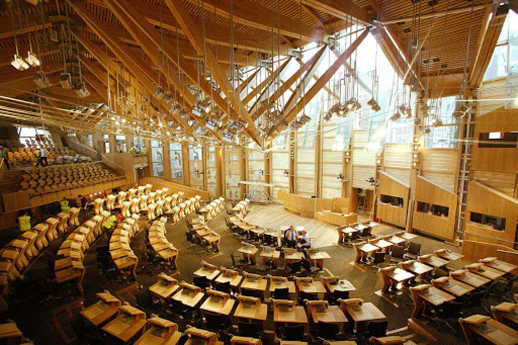 The Scottish Assembly opened in 2004, 3 years late at cost of £414 million (Credit: EMBT)