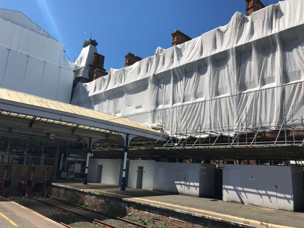 Abandoned by its owner, the station hotel is now cocooned in protective plastic (Credit: NR)