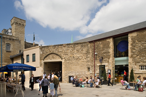 People enjoy the historic setting at Oxford Castle